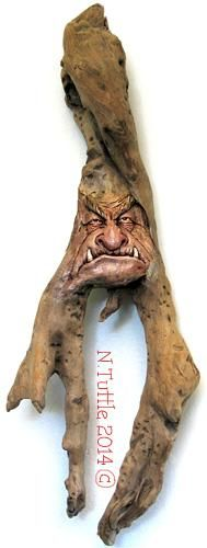 """""""The Evil Within""""    17 inches tall and 5½ inches at his widest point.  I chose to paint the entire carved area of the face   onthis piece due to the dark, discolored wood.    All done with oil paints.  Signed and dated:   N. Tuttle 11/9/14"""