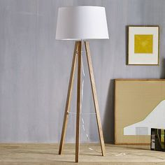 Tripod Wood Floor Lamp #WestElm-- I like this because it would incorporate some more wood. $250