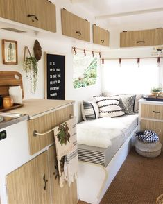 Camper converted to tiny house decorating and living room/kitchen idea.