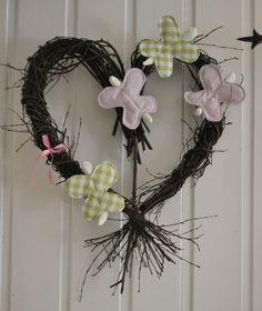 Heart wreath with butterflies.