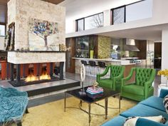 Photo of  project in Los Angeles, CA by Jeneration Interiors   I like how the living spaces are all together yet very seperate and the upper windows and fireplace