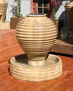 Ripple Vase Fountain. This modern ripply fountain is suited for a business or a home. Compliment it by surrounding the fountain with plants or flowers.