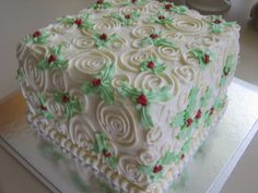 """Christmas Swirls and Holly - This was my attempt at a lovely design by arrostx. I was looking for something simple to do a """"real"""" buttercream design - my piping skills are virtually non-existent :( It was loads of fun playing with the icing though.  The cake is four layers of chocolate genoise, soaked in simple syrup and filled with a chocolate custard buttercream. Decorated with American vanilla buttercream."""