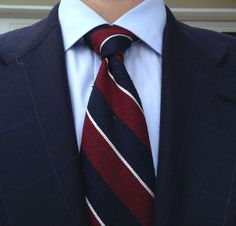 Navy jacket with windowpane plaid, light blue shirt, red, white, & navy repp tie