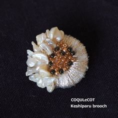 Brooch like, such as the sun and the flowers were together.  The accent of simple clothes. .  COQULeCOT Keshiparu brooch  http://kanden43.jp/?pid=1594851  #COQULeCOT #Keshiparu #pearl #brooch #accessories #NaturalAccessories #LadiesFashion #FashionAccessories #NaturalFashion #fashionaccessories #miscellaneousgoods #NaturalGoods #Natural #Naturalsystem #selectshop #Japan #madeinjapan