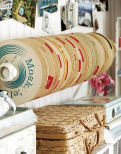 Ribbon Spool Harbor hooks, rods, and other items can be called into use, like this towel rack holding spools of vintage ribbon. A benefit of setting colorful collections of ribbons, buttons, and fabrics in plain sight is that they're pleasing — and inspiring — to look at.    Read more: Creating a Craft Room - Country Living