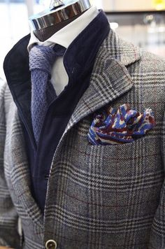 Stylish layering for the autumn season. Glen plaid jacket paired with knit tie and wool floral print pocket square.