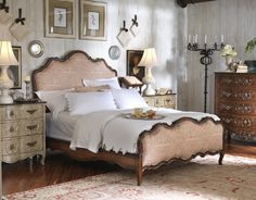 Love the toile upholstered French bed