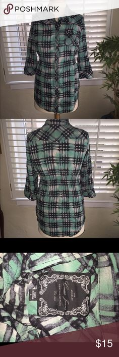 Guess teal and black plaid button down, L Lightweight and versatile plaid top in a gorgeous color combo with elastic on both sides of waist to accentuate curves.  Longer length with sleeves that can be buttoned up to 3/4 length.  Can be worn at the office, paired casually w jeans or as a cover up to the pool/beach.  Size is L but fits more like a medium.  Like new, make me an offer! Guess Tops Button Down Shirts