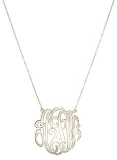 This gorgeous classic monogram necklace is perfect for everyday wear. As seen on celebrities, this necklace adds a twist to the classic name plate.
