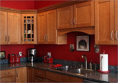 Red Kitchen Walls With Medium Brown Cabinets The Rectangular Clad In Cherry
