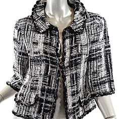 """CHANEL Black White Silver Tweed Jacket w/Sequins Excellent condition - Circa 2007P 34% Rayon/24% Silk/12% Wool/10% Nylon/4% Acrylic100% SilkStyle # - P29926V19645 - Made in FranceSilver ribbon woven in and with the wonderful clear sequins scattered about - just to give it that added POP!Gorgeous black & white tweed jacket. beautiful-blackbuttons with signatureCC logo. Everything you expect from CHANEL.Chanel Size 38 / US S 4Length- 20""""Bust- 37"""" all aroundWaist- 36"""" all…"""