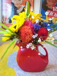 Red Fiesta pitcher with flowers