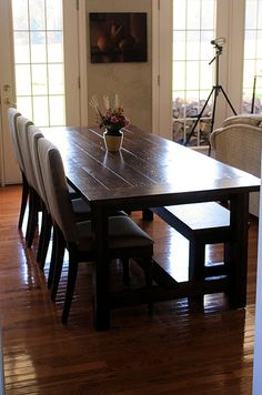 This is exactly the table I am looking for to go in my kitchen. Big, sturdy, rustic and totally expecting to be nicked, scratched, gouged because it's okay! It's a work/family gathering/statement piece that will last for decades and never go out of style. I am looking in my area for a woodworker who can make this for me of reclaimed oak wood.