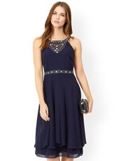 """An understated, elegant floor-length dress with a lace panel, a softly-ruched, sweetheart bodice, and a simple, layered skirt that falls at the ankles with grace. The sleeveless design and delicate, cut-away back create a classically feminine look, while the hand-embellished neckline provides a subtle touch of luxe. Features a button loop fastening at the top, plus a back zip. Matching shrug available. Model wears UK 8/UK S/EU 36/US 4. Model height is 175 cm/5'9""""."""