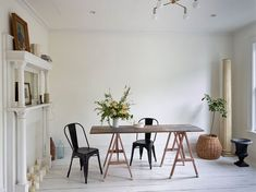 Most of the furnishings in the pared-down studioarea were sourced locally from vintage shops. The brass ceiling light isa custom design by Zio & Sons, made with parts sourced from a Chinatown lighting shop.The flowers on the dining table are from Hops Petunia in Kingston.