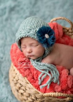 Sweet knit baby bonnet shown in the dusty blue color. Flower clip is not included but sold separately. This is a super soft blend so it is great