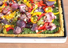 Gluten-free roasted onion and pepper pesto tart