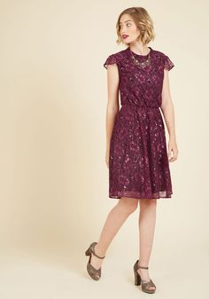 Fanfare Variable Lace Dress in Magenta   Mod Retro Vintage Dresses   ModCloth.com Guarantee yourself a show-stopping entry to the fete by arriving in this floral lace dress - a ModCloth exclusive! Detailed with a mock neck, sheer cap sleeves, and metallic accents atop a black backdrop, this stunning fuchsia A-line creates a look deserving of full-on flourish.
