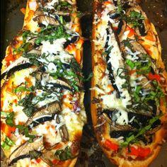 French bread pizza with mozzarella, onions, peppers, portobello ...