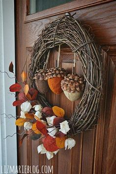 I love this simple wreaths and the acorns use pine cone tops and fabric wrapped styrofoam for the bottom.  Very cute!