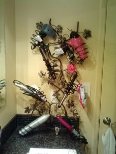 Wine rack hair dryer / flat iron! My own idea