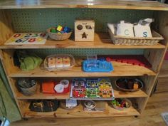 I'm planning to do a shelf in the dining room that is laid out Montessori style with the activities that we are working on that week/month.