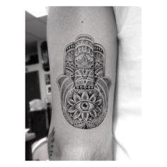 Hamsa tattoo aka eye of Fatima Done by Dr Woo Tattoo