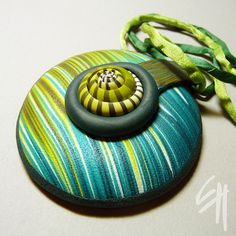 Polymer clay pendant in turquoise and teal