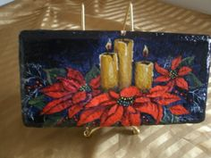 Red Poinsettia And Candles Painted On Brick by ArtistTooStudios, $50.00