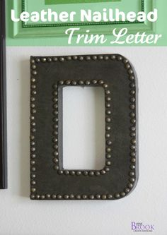DIY ---  Paper mache letter gets a makeover with faux leather and nailhead trim.