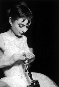Audrey Hepburn with her Oscar trophy.