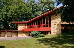 A Frank Lloyd Wright-Designed Home You Can Stay In: The ELAM HOUSE in  Austin, Minnesota is one of Wright's largest Usonian homes. The house features limestone piers, floor to ceiling fireplaces and over 100 windows through which to view the rolling Minnesota countryside. Completed in 1951, Elam House is one of four Wright homes in southern Minnesota. The home now operates as an 8-bedroom guesthouse with nightly rates starting at $225 per night.: