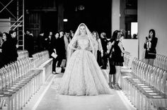 Pin for Later: If You Thought Catwalk Couture Looked Amazing, Wait Until You Go Backstage  The Zuhair Murad bride takes to the catwalk for one last rehearsal.