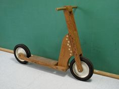 This is a very cool vintage push scooter, possibly from a Popular Mechanics / Popular Science set of plans. It appears to be home-made, but constructed very well given that. Made of solid oak, heavy duty hardware and hard rubber and steel wheel set, this scooter held up to the toll any young rider could give. Definitely a one-of-a-kind piece perfect for any vintage bike or toy collector, or as a very cool wall-hanger.    Appropriate vintage age and wear, signs of normal use. Circa 1950s-60s…
