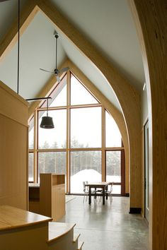 Glulam is fabricated following the same formula as plywood: thin sheets of wood glued together.. contemporary family room Dennis Wedlick images