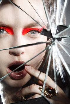 Model Aysche Teifenbrunner Post Contains: woman looking into broken mirror, bold makeup, colorful makeup, shattered mirror, beauty pictures, beauty images, broken glass, mirror reflection, graphic...