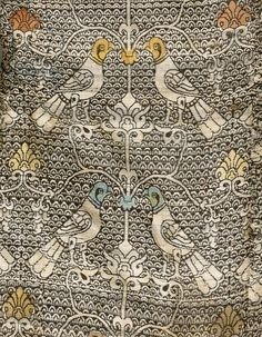 Detail of a Central Asian silk robe, 11th or  12th century. decoration with repeated confronted hawks over a lattice formed by thin stems and composite palmettes