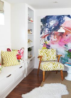 Abstract strokes of fuchsia and watermelon in the painting invigorate this bedroom nook. | Photographer: Valerie Wilcox | Designer: Jenna Cadieux