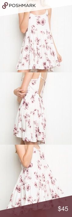 Brandy Melville Jada dress White floral design Never worn Not sold anymore Brandy Melville Dresses Mini