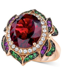 A rose has never looked so sweet! Le Vian's stunning flower ring is set in 14k rose gold and features oval-cut garnet (7-5/8 ct. t.w.), round-cut white topaz (3/8 ct. t.w.), round-cut tsavorite (3/8 c