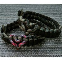 Off Center Heart Paracord Bracelet Shown in Black inside, Camo outside and Neon Pink Camo and Camo Hearts