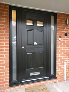 Popular black composite door fitted in Hemel Hempstead. Porch Doors, Entry Doors, Windows And Doors, Upvc Windows, Entryway, Black Composite Front Door, Victorian Front Doors, Georgian Doors, Purple Front Doors