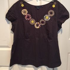 NWOT! Boden blouse NWOT! Circles of colorful patterns highlight this fun top from Boden. Slate grey with empire waist in back and front. Elasticized short sleeves. Never worn, unfortunately. It needs a new home  Boden Tops Blouses