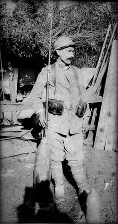 WWI, French soldier, 311th Infantry Regiment,  posing next to a couple of artillery shells. Source: greatwarimages.com