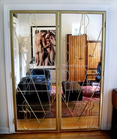 A custom designed gold door for an interior of a home fabrication and installation in Chicago, IL. Gold Door, Iron Windows, Window Well, Custom Windows, Custom Metal, Window Coverings, Custom Design, Chicago, Storage