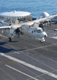 A U.S. Navy E-2C Hawkeye aircraft from Carrier Airborne Early Warning Squadron (VAW) 113 lands on the aircraft carrier USS Ronald Reagan under way in the Pacific Ocean Feb. 7, 2011.