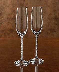 Exquisite crystalline toasting flutes by Swarovski. Perfect wedding gift for bride and groom. $329 #gift #wedding