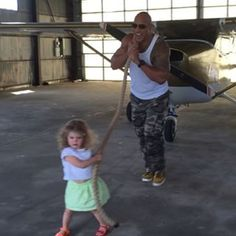 Dwayne Johnson, aka The Rock, dropped 15 seconds of feels onto Instagram yesterday when a little girl visited the set of his new film, Central Intelligence, and he let her think she was pulling a plane unaided. | The Rock Let A 2-Year-Old Girl Think She Was Pulling A Plane And It's A Feels-Fest