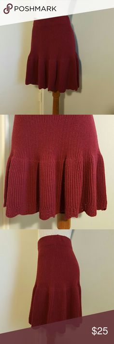"""Anthropologie LeifNotes Burgandy Sweater Skirt S Lovely Fall and Winter weight 'Spun sweater skirt' by LeifNotes from Anthropologie.  Size women's Small  or 4 to 6.  Gorgeous burgandy / wine color.  Scalloped hemline, rib knit, fitted through waist, flares out at the hips. Used and in good condition with slight piling, but still looks great!  Wide elastic waistband, unlined.  Measures 27"""" at waist, 18.5"""" long.  Cotton/wool/nylon/spandex knit. Anthropologie Skirts Mini"""